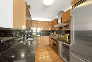 Contemporary Kitchen with flush light, Galley, Flush, Simple granite counters, Wall Hood, European Cabinets, gas range