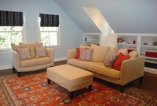 Traditional Attic with double-hung window, Hardwood floors, Built-in bookshelf, High ceiling