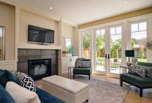 Contemporary Living Room with French doors, Transom window, Crown molding, Hardwood floors