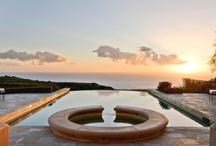Modern Patio with Infinity pool, Ocean view, Pool with hot tub, exterior stone floors, Fence, Green Velvet Boxwood