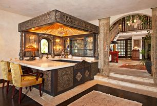 Mediterranean Bar with slate floors, can lights, Arched window, Wall sconce, Standard height, Chandelier