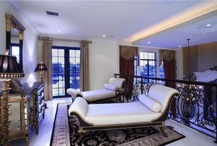 Traditional Living Room with stone tile floors, can lights, Casement, Crown molding, Standard height, French doors