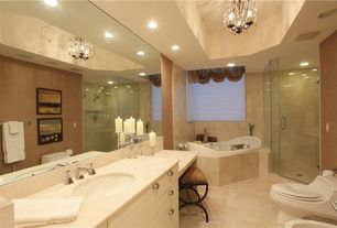 Traditional Master Bathroom with full wall mirror, can lights, large ceramic tile floors, Chandelier, Chrome cabinet hardware