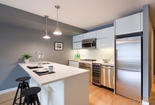 Modern Kitchen with Nuevo living briggs counter stool, Bamboo floors, Corian Designer White Solid Surface, Breakfast bar