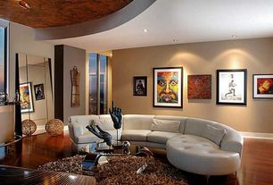 Eclectic Living Room with Hardwood floors, Standard height, Ceiling fan, can lights