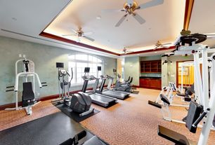 Traditional Home Gym with Ceiling fan, Carpet, Built-in bookshelf, Arched window, Casement, Standard height, French doors