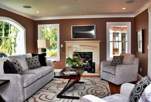 Modern Living Room with metal fireplace, Arched window, Laminate floors, specialty door, Crown molding, Carpet
