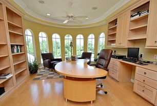 Modern Home Office with Ceiling fan, Cathedral ceiling, Built-in bookshelf, Crown molding, Arched window, Hardwood floors