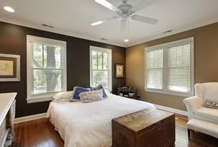 Country Guest Bedroom with Crown molding, Ceiling fan, Hardwood floors