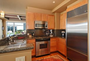 Traditional Kitchen with Built In Refrigerator, Pendant light, gas range, built-in microwave, Flat panel cabinets, Flush