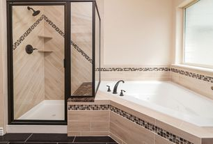 Modern Master Bathroom with Dailtile 6x24 dune p620, Daltile flint 1 x 1 random sa55, Porcelain tile, Master bathroom