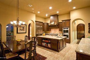 Traditional Kitchen with U-shaped, Stone Tile, six panel door, can lights, Custom hood, Undermount sink, full backsplash