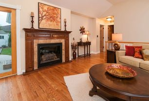 Traditional Living Room with Standard height, six panel door, Hardwood floors, Fireplace, French doors, stone fireplace