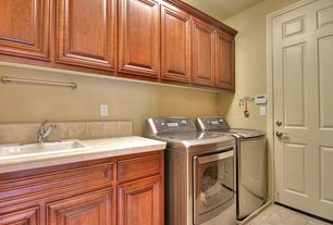 Traditional Laundry Room with simple marble floors, Built-in bookshelf