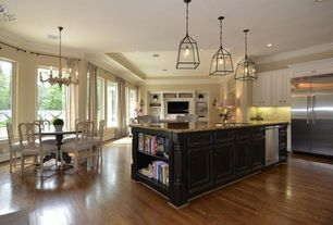 Traditional Kitchen with Flat panel cabinets, Kitchen island, picture window, Crown molding, Hardwood floors, U-shaped