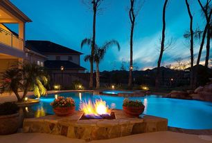 Tropical Swimming Pool with exterior stone floors, Deck Railing, Pool with hot tub, Fire pit, Fence
