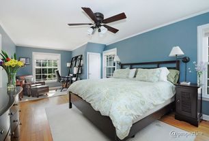 Modern Master Bedroom with Bamboo floors, Barn door, flush light, Hardwood floors, Ceiling fan