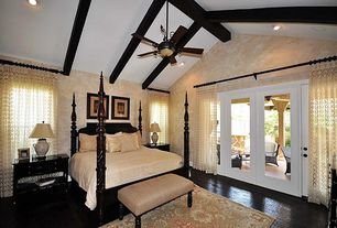 Traditional Guest Bedroom with Ceiling fan, Laminate floors, High ceiling, Carpet, French doors