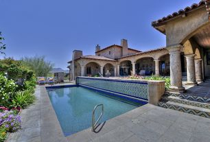 Mediterranean Swimming Pool with Lap pool, exterior stone floors, French doors, Fence, Gate