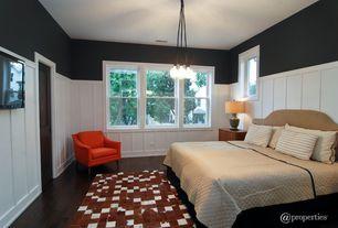 Modern Guest Bedroom with flush light, Hardwood floors