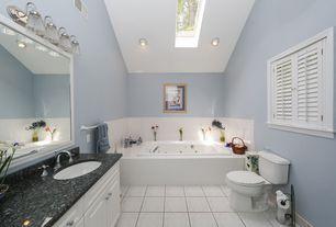 Traditional Full Bathroom with Ms international cambrian black granite counter, Complex Granite, Raised panel, Skylight