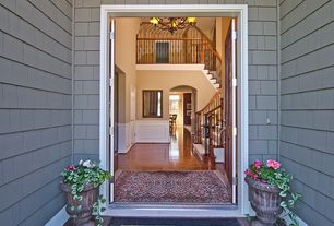 Traditional Front Door with exterior concrete tile floors, Casement, exterior tile floors, six panel door