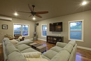 Traditional Living Room with Bamboo floors, Standard height, Ceiling fan, Paint 1, can lights, Casement