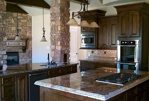 Rustic Kitchen with Paint 1, Complex granite counters, L-shaped, Kitchen island, six panel door, Stone columns, Glass Tile