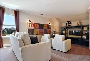 Eclectic Home Theater with Drapery rod, Carpet, Built-in bookshelf, double-hung window, Home theater seating, Paint, Paint 1