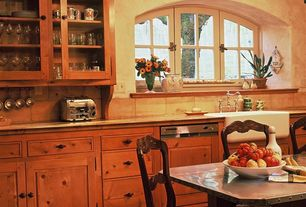 Traditional Kitchen with Stone Tile, Chandelier, Arched window, Framed Partial Panel, Breakfast nook, Farmhouse sink