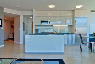Contemporary Kitchen with Interior white louvered door, Dura Supreme Cabinetry Hanover Thermofoil, Kitchen island, Flush