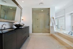Contemporary 3/4 Bathroom with frameless showerdoor, can lights, Double sink, Wall sconce, stone tile floors, drop in bathtub