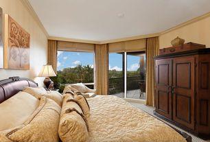 Mediterranean Guest Bedroom with Carpet, Crown molding