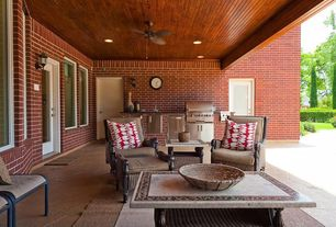 Country Patio with Outdoor kitchen, exterior stone floors, French doors