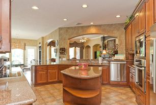 Mediterranean Kitchen with wall oven, Raised panel, stone tile floors, dishwasher, can lights, Kitchen island, Breakfast nook