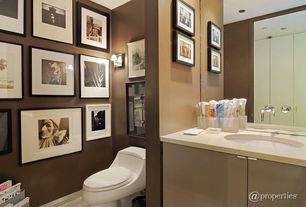 Contemporary Powder Room with Wall-mounted faucet, Gallery wall, Wall sconce, Undermount sink, Solid surface countertop