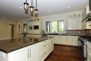 Modern Kitchen with Penny Tile, L-shaped, Undermount sink, Pendant light, Simple granite counters, Inset cabinets