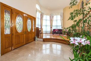 Traditional Entryway with Glass panel door, stone tile floors, Standard height, can lights