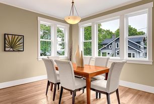 Modern Dining Room with Standard height, Crown molding, Hardwood floors, double-hung window, flush light