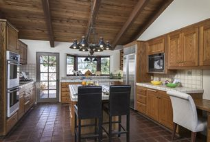 Eclectic Kitchen with full backsplash, French doors, Standard height, Built In Refrigerator, Raised panel, U-shaped, Casement