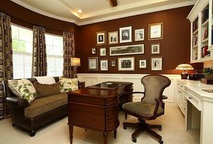 Traditional Home Office with Standard height, Carpet, Built-in bookshelf, can lights, Paint, Crown molding, Casement