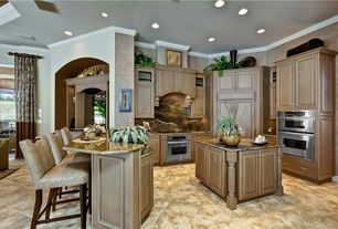 Eclectic Kitchen with specialty window, Complex Granite, Custom hood, Crown molding, full backsplash, Glass panel, wall oven