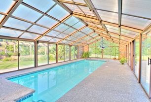 Modern Swimming Pool with French doors, Pathway, exterior stone floors, Indoor pool, Skylight