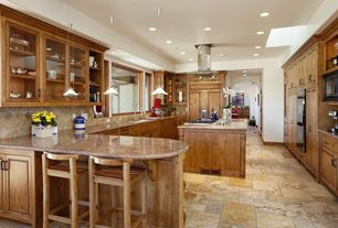 Craftsman Kitchen with Pendant light, Simple granite counters, Glass panel, Built In Panel Ready Refrigerator, can lights