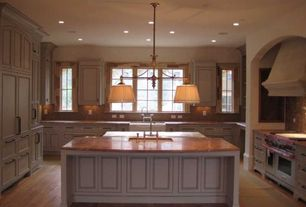 Traditional Kitchen with Flat panel cabinets, Pendant light, Farmhouse sink, Simple marble counters, Laminate floors