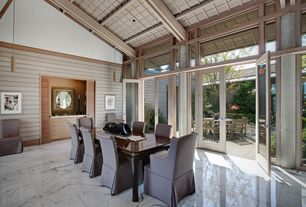 Traditional Dining Room with Pendant light, French doors, Transom window, simple marble tile floors, High ceiling