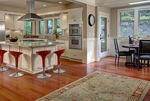 Contemporary Kitchen with Simple Granite, Coca-cola scooper bar stool, Flat panel cabinets, Simple granite counters, Skylight