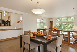 Modern Dining Room with Laminate floors, Pendant light, Loft