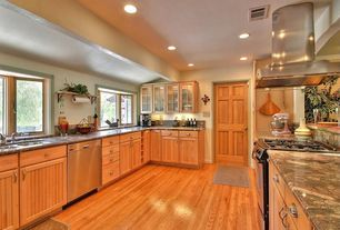 Craftsman Kitchen with Hardwood floors, Complex granite counters, Glass panel, Destiny: hampton (beadboard) cabinets, Galley