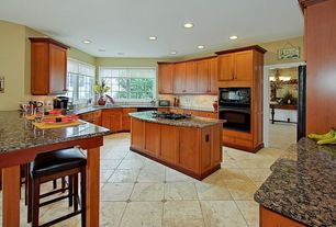 Traditional Kitchen with Kitchen island, Undermount sink, Complex granite counters, Flat panel cabinets, U-shaped